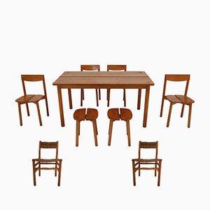 Juego de comedor vintage formado por una mesa, seis sillas y dos taburetes de Pierre Gautier Delaye, años 60