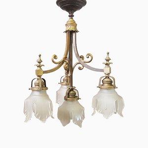 Lámpara de araña antigua con cinco puntos de luz