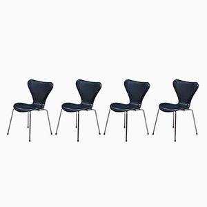 Model Seven 3107 Black Leather Chairs by Arne Jacobsen for Fritz Hansen, 1980s, Set of 4