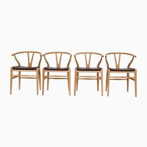 Vintage Modell CH24 Esszimmerstühle mit Gestell aus Eiche von Hans J. Wegner für Carl Hansen & Søn, 4er Set