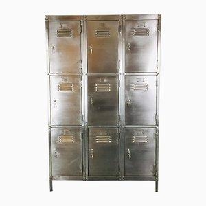 Taquilla vintage de acero con nueve compartimentos, años 20