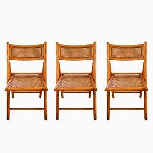 Sedie pieghevoli in legno e canna, anni '50, set di 3