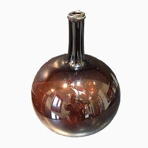 Botella francesa antigua de vidrio ámbar, década de 1820