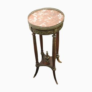 Tavolino alto antico in mogano con ripiano in bronzo e marmo