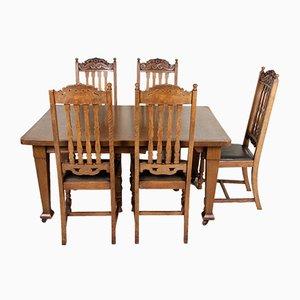 Set da pranzo antico in legno di quercia intagliato