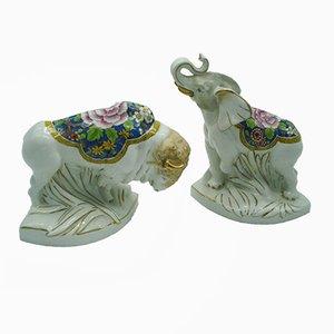 Sujetalibros en forma de elefante y bisonte de porcelana,de ALADIN, años 30. Juego de 2