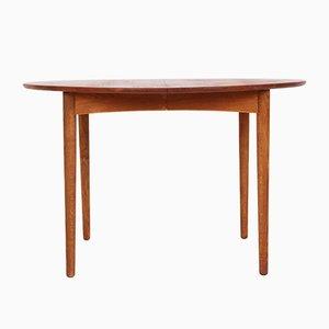 Mesa de comedor extensible redonda de roble y teca, años 50