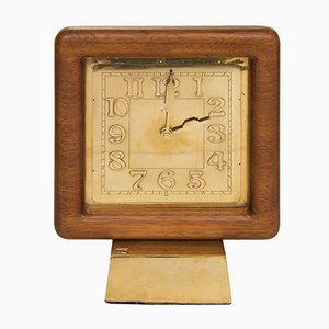 Reloj Mid-Century de teca y bronce, años 60