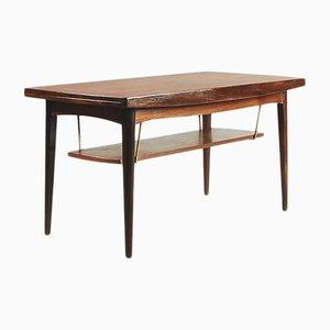 Mesa de centro ajustable danesa de teca con estante de latón, años 60
