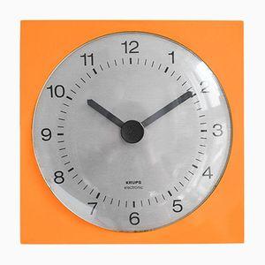 Reloj de pared moderno naranja de Krups, años 60