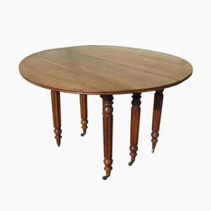 Tavolo allungabile in noce, fine XIX secolo