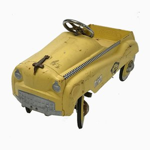Taxi infantil a pedales amarillo, años 60