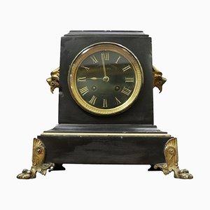 Reloj antiguo de mármol y bronce dorado, década de 1880