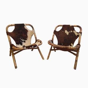 Poltrone vintage in pelle di mucca e bambù, anni '70, set di 2