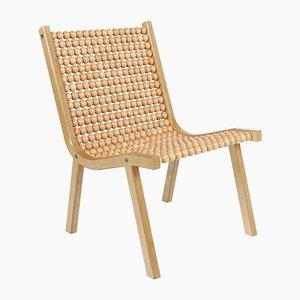 o432 Sessel mit Buchenholzkugeln von Jean-Frédéric Fesseler