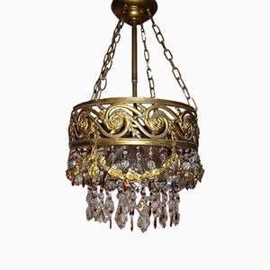 Lámpara de araña en cascada estilo antiguo de cristal dorado, años 20