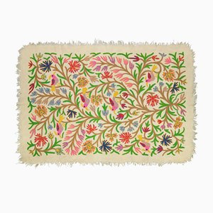 Alfombra con motivos florales de Tikau