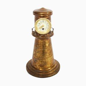 Reloj en forma de faro de latón, años 20