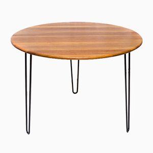 Mesa de comedor redonda de teca con patas de acero, años 60