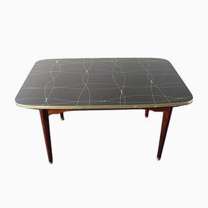 Ausziehbarer Mid-Century Tisch mit schwarz- und goldlackiertem Glas, 1950er