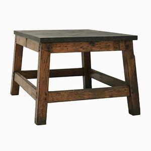 Mesa industrial de madera con tablero de piedra azul, años 60