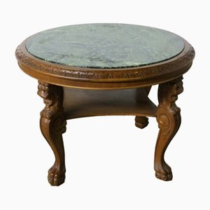 Mesa de centro vintage con tablero de mármol y patas talladas