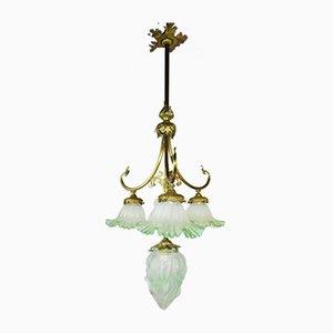 Lámpara de araña antigua de bronce y vidrio verde