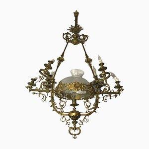 Lámpara de araña francesa Rococó de latón, años 20