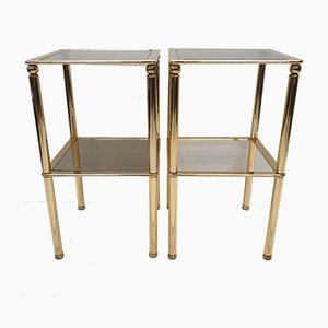 Mesas auxiliares de acero chapado en oro y cristal ahumado, años 80. Juego de 2
