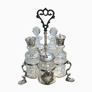 Juego de alilñadores antiguo de vidrio tallado y baño de plata 1863
