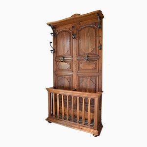 Appendiabiti grande antico in legno di castagno intagliato e ferro battuto