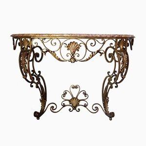 Mesa consola antigua de hierro forjado con tablero de mármol