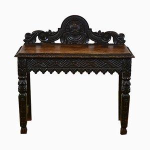 Consola victoriana gótica antigua de roble tallado, década de 1870
