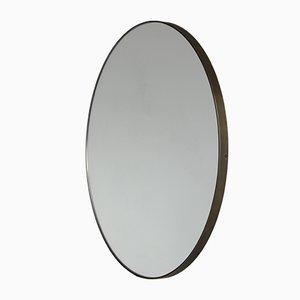 Specchio rotondo Orbis argentato con cornice in bronzo di Alguacil & Perkoff Ltd