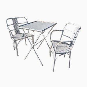 Mesa y sillas españolas Mid-Century de hierro fundido, años 70. Juego de 3