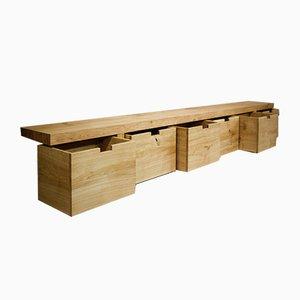 Panca in legno di quercia massiccio oliato con scomparti su ruote di ILYT per ILYT