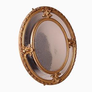 Specchio ovale vittoriano in legno dorato