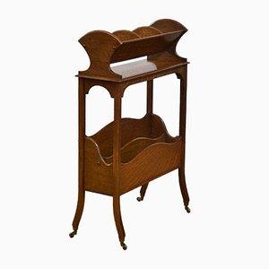 Libreria o portariviste Arts & Crafts in quercia su ruote in ottone, anni '10