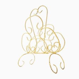 Revistero vintage en forma de mariposa de latón dorado