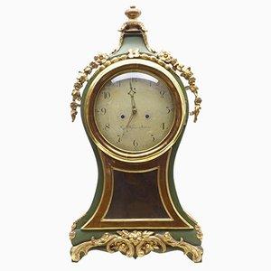 Reloj sueco antiguo dorado y pintado