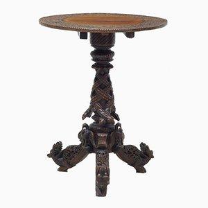 Mesa plegable anglo india de padouk tallado del siglo XIX