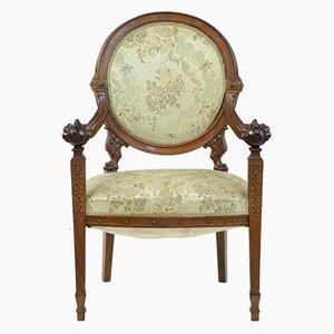 Französischer Sessel mit Gestell aus geschnitztem Nussholz, 19. Jh.