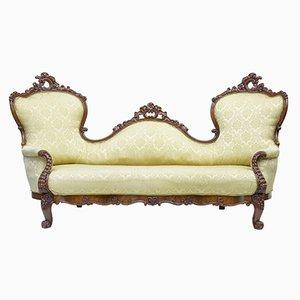 Sofá victoriano antiguo de caoba tallada