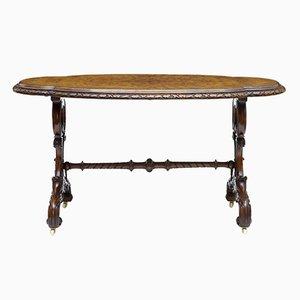 Tavolino ovale antico in legno di noce intagliato