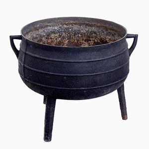 Recipiente antiguo de hierro fundido
