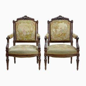 Französische Sessel mit Gestell aus geschnitztem Nussholz, 19. Jh., 2er Set