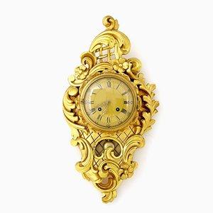 Reloj de pared sueco de madera dorada tallada de Westerstrand, años 40
