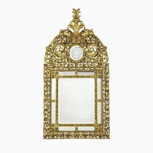 Specchio antico dorato in legno intagliato
