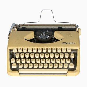 Macchina da scrivere bianca di Olympia, anni '50