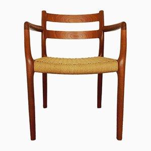Modell 67 Armlehnstuhl aus Teak von Niels Otto Møller für J.L. Møllers, 1960er